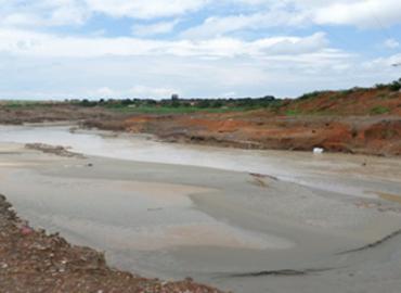SICOMINES face au défi du Millénaire: Après avoir pollué l'environnement, comment l'entreprise a bafoué les droits des communautés
